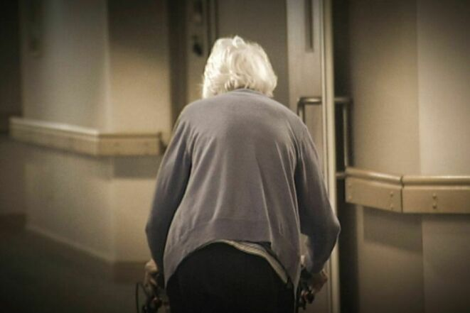 Elderly walking towards light